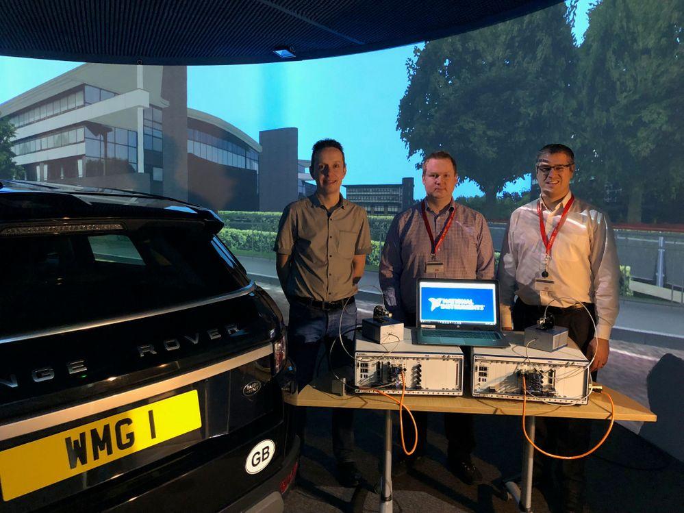 Dr Erik Kampert, Dr Matthew Higgins, Dr Jakobus Groenewald receive the 5G mmWave platform inside WMGs 3xD Simulator.